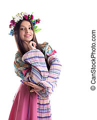 Beauty girl with garland posing in russian costume