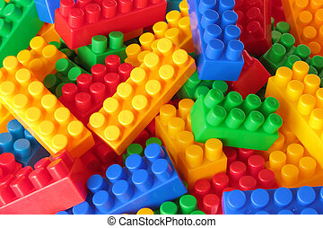 Toy color bricks background. Blocks close up.