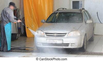 Man washing a car timelapse - Man washing a car