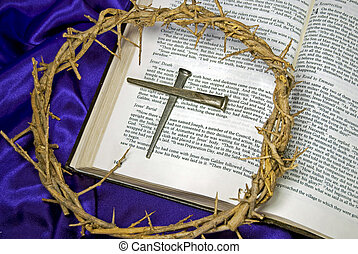 Easter Crown - Crown of thorns and spikes on Holy Bible.
