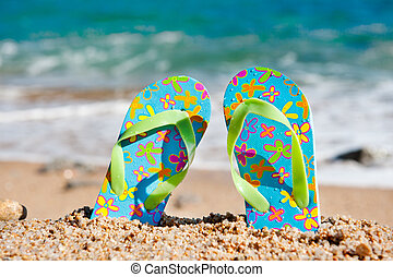 Standing flip flops at the beach - Flip flop sandals at the...