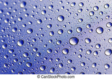 Water drops background - Close-up of water drops on textured...