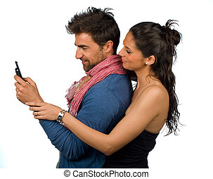 Cell phone addiction - Gril curiously watching over her...