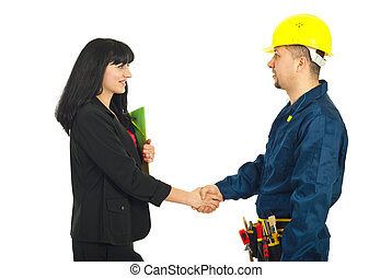 Businesswoman gives handshake with worker - Business woman...