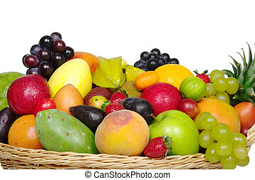 A big variety of exotic fruits in a basket from close