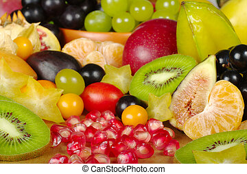 A big variety of exotic fruits on a wooden board