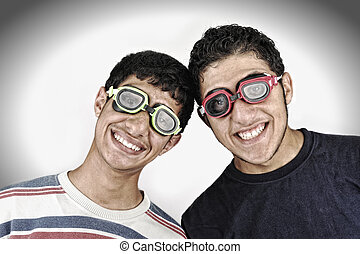 Two happy funny teenagers together, portait