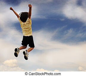 Kid celebrates, high jumping up, successful winner
