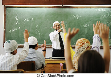 Muslim male  teachers in classroom with childrens
