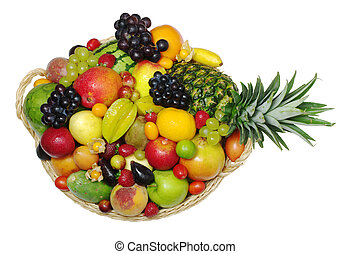 A big variety of exotic fruits in a basket photographed from...