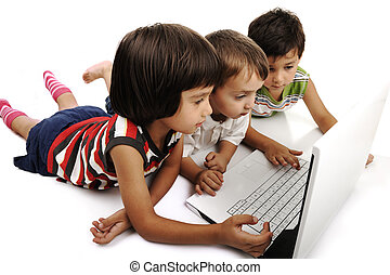 Group of children playing on white laptop together. Isolated on white.
