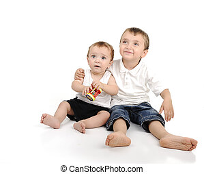 Two little brothers sitting, isolated.