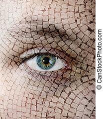 Cracked skin, closeup of green eye