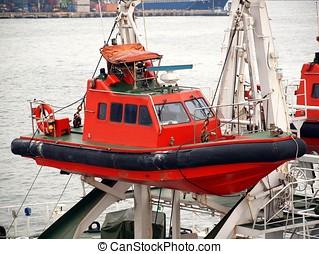 Coastguard Rescue Boat - An inflatable dinghy is part of a...