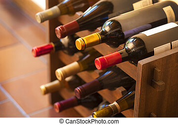 Red and white wine bottles stacked on rack
