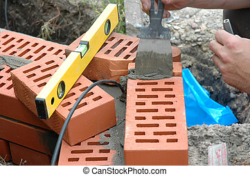 bricklaying - Wall under bricklaying with brick and cement