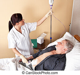 Infusion - A nurse gives a patient an infusion