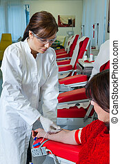Blood from the blood donation - Nurse and patient blood...