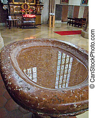 Holy water - A vessel with holy water in a church