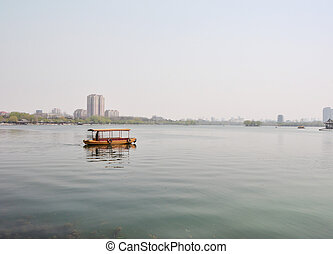 chinese river boat in lake - a old chinese boat traveling...