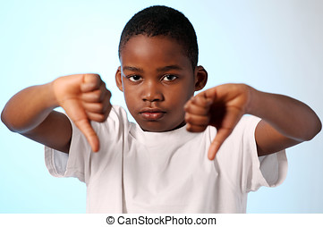 Boy thumbs down gesture - African boy making thumbs down...
