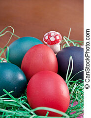 easter eggs and mushrooms over a dark background