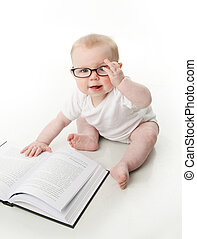 Baby reading wearing glasses