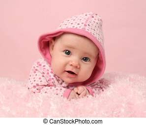 Cute baby girl - Portrait of adorable baby girl on pink...