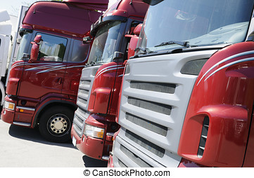 trucks on line - brand new trucks standing on line,...