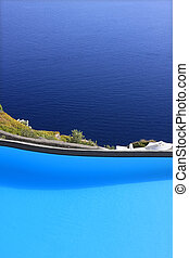 Swimmingpool set on a hill overlooking the sea