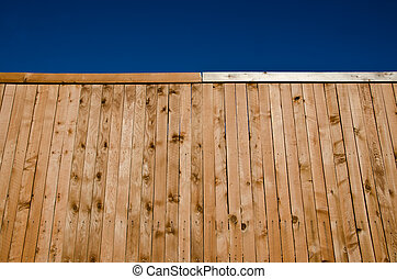 Wooden fence with blue sky