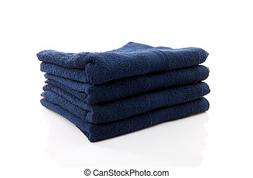 pile of dark blue towels over white background