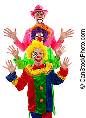 Three people dressed up as colorful funny clown