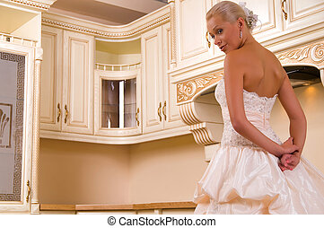 beautiful bride in the kitchen and laughs
