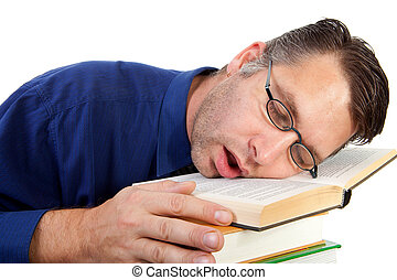 male nerdy geek fall asleep with face on pile of books over...