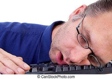 male nerdy geek fall asleep on keyboard in closeup over...