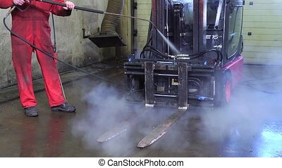 High pressure spray cleaning - Man, using a high pressure...