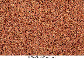 Linseed grain forming a textured background.