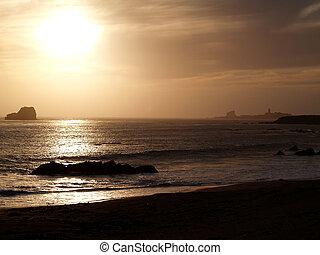 Golden Sunset - A beautiful golden sunset with a lighthouse...