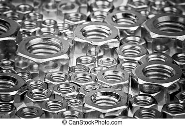 Screw nuts - Assorted screw nuts background, selective focus