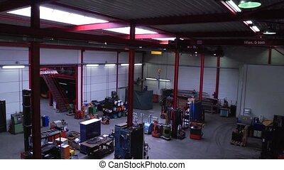 Workshop pan - Pan through a large mechanics workshop, seen...
