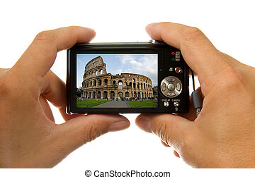 Hands with digital photo camera taking picture