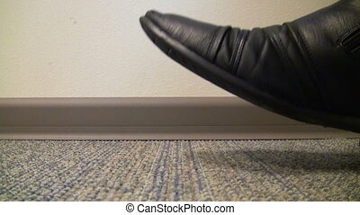 Men s shoes tapping on the floor