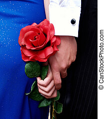 Couple Holding Hands and a Rose - Couple holding hands and a...