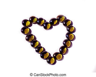 Heart of golden beads on a white background