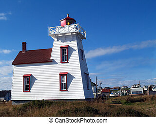 PEI Lighthouse Outside Village - Lighthouse next to a...