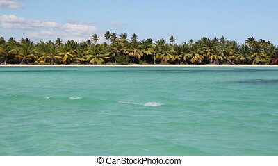 Tropical shoreline pan. L to R. - Panning across a tropical...
