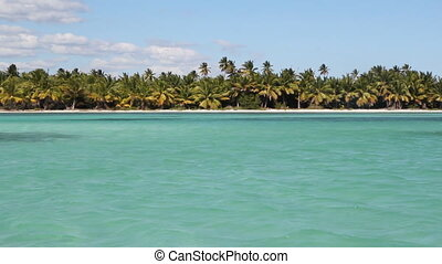 Tropical shoreline pan. R to L. - Panning across a tropical...