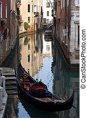 Canal Scene, Venice, Italy - A gondola moored beside a set...