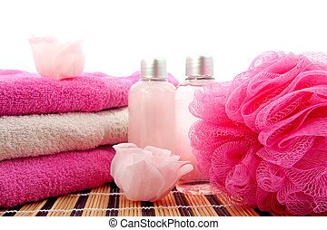 pink spa bathroom accessory on cane mat over white...